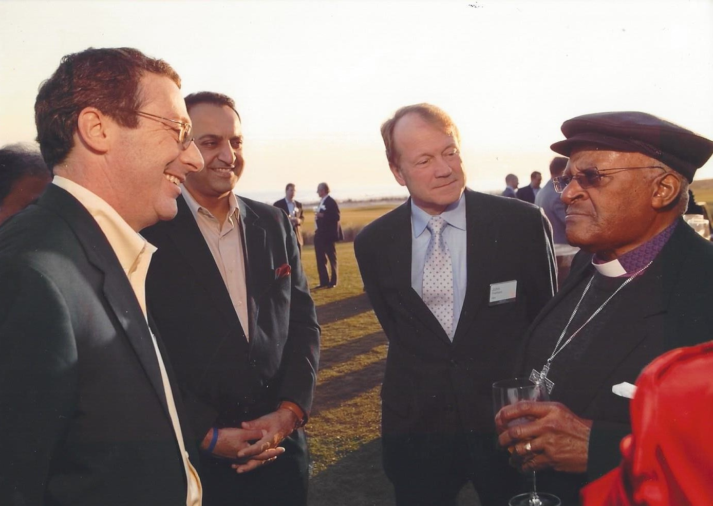 Chatting with Desmond Tutu, Cisco CEO John Chambers and BBC Broadcaster Riz Khan at a CEO summit.