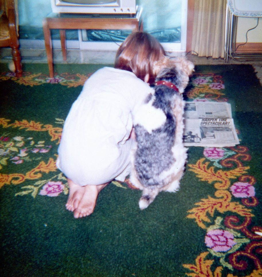 A young Susan and her childhood dog, Dugan.