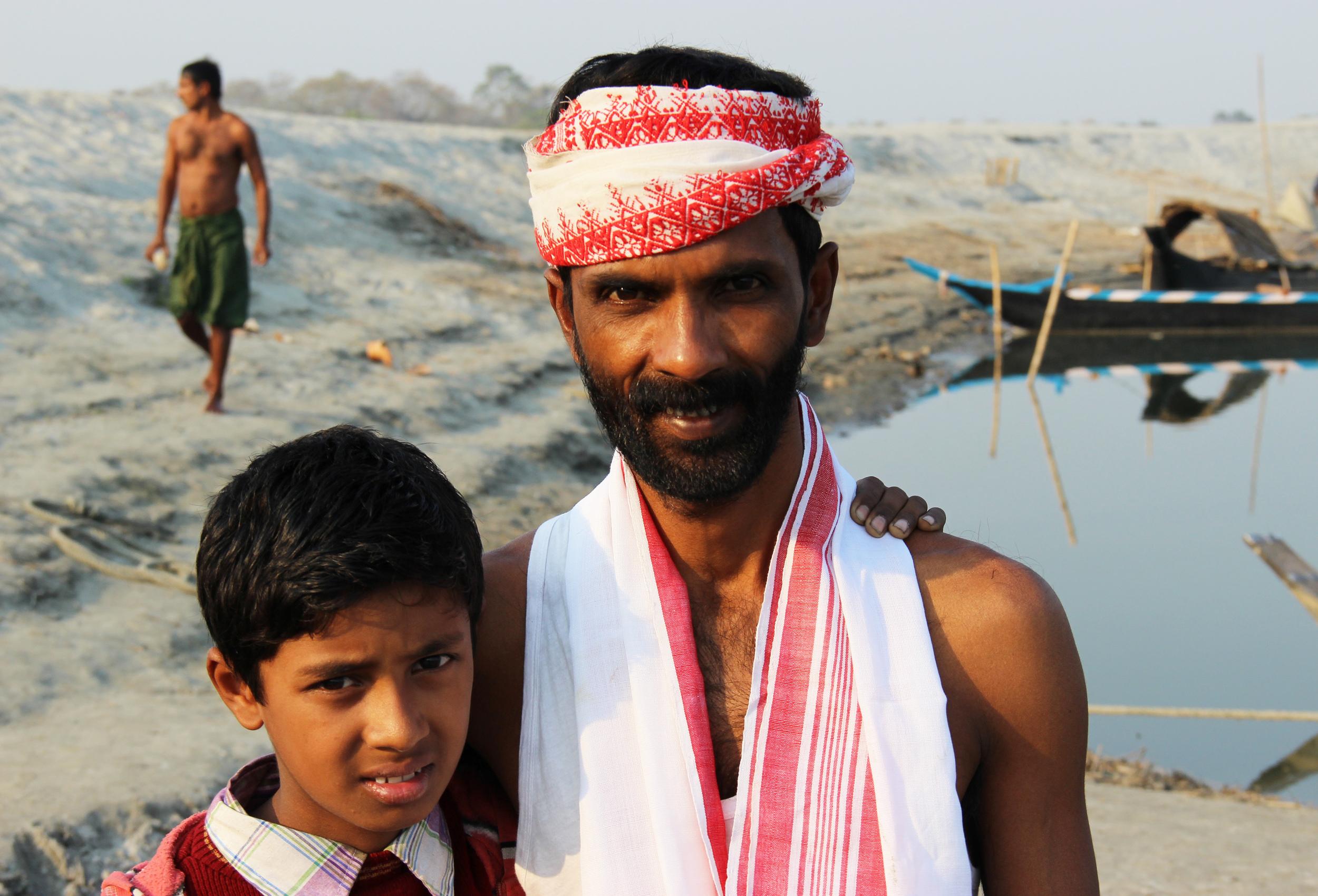 Bishnu Das (singer) & his son Amlan, Majuli Island, January 2014 © Edith Nicol