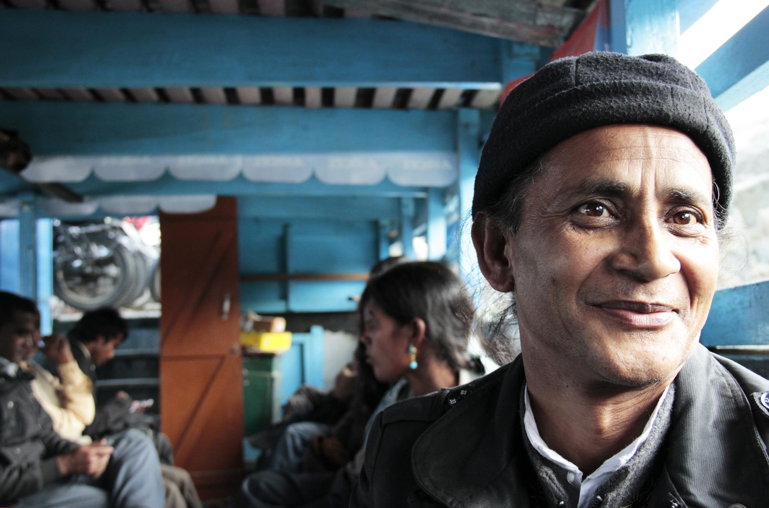 Govinda in the boat from Jorhat to Majuli, January 2014 © Edith Nicol