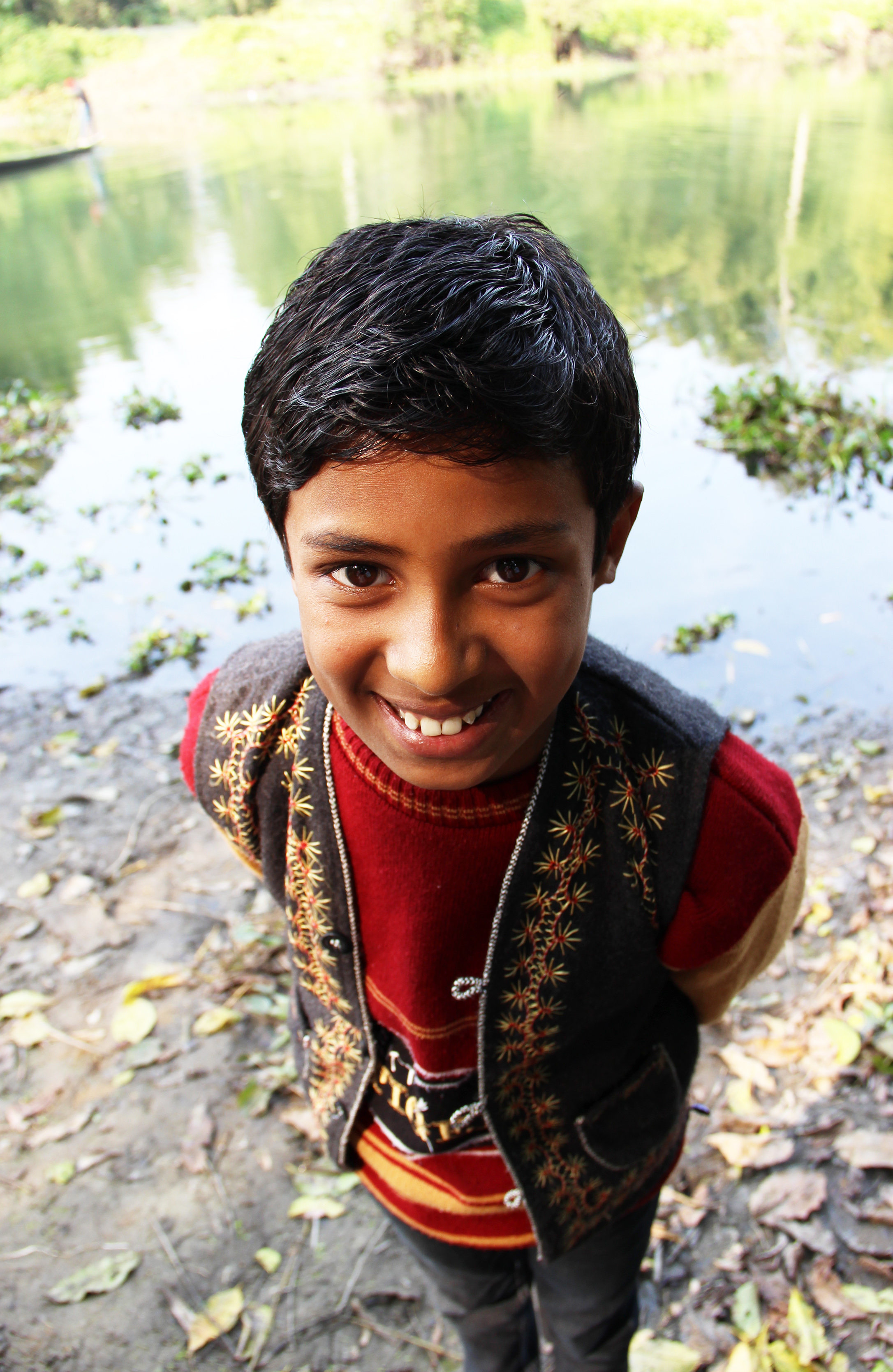 Amlan, son of Bishnu Das, along 'his' river, Majuli Island, January 2014 © Edith Nicol