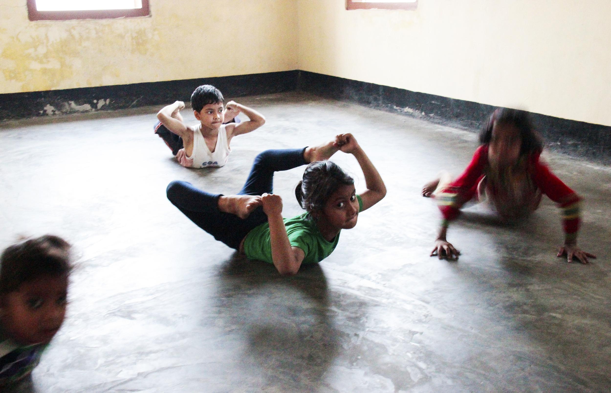 Children during their sattriya dance class, under the eyes of 'Guruji' Govinda, Majuli Island, January 2014 © Edith Nicol