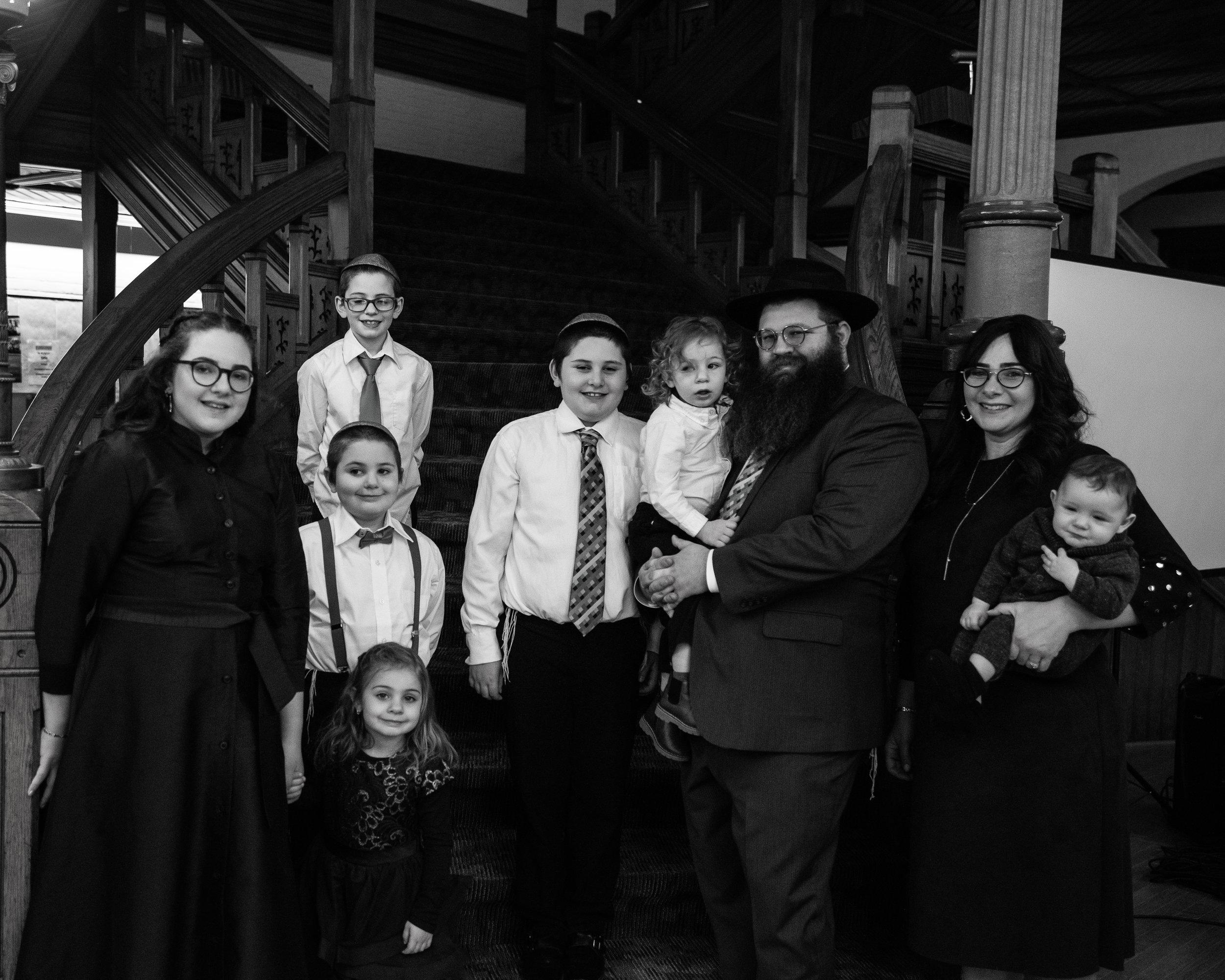 The Elkan Family: Shlomo, Devorah, Hadassah, Yanky, Menachem, Yosef, Chana, Beri, and Izzy