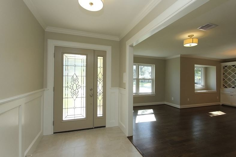 Looking at the front door and the dining area.