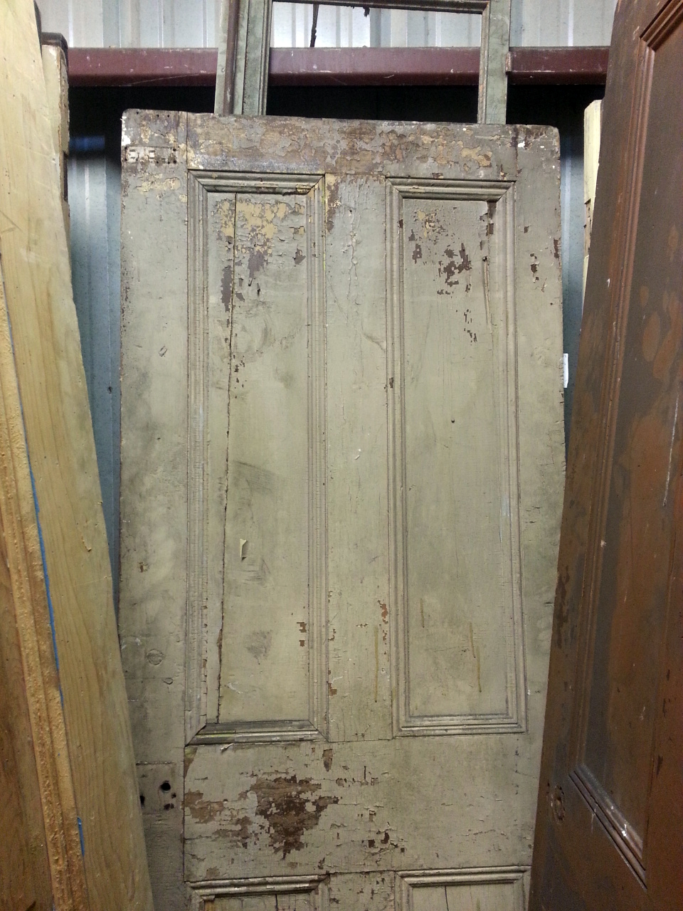 This is the door! It was always our fav. Subtly & not shown in this pic, chartreuse if peaking out under the grayish finish. This door is a bit small so we'll build a frame around it and have that finished. To make this safe for a home we'll have it wire brushed to remove the flakes then sealed. We'll hang it as a slider in the family room.
