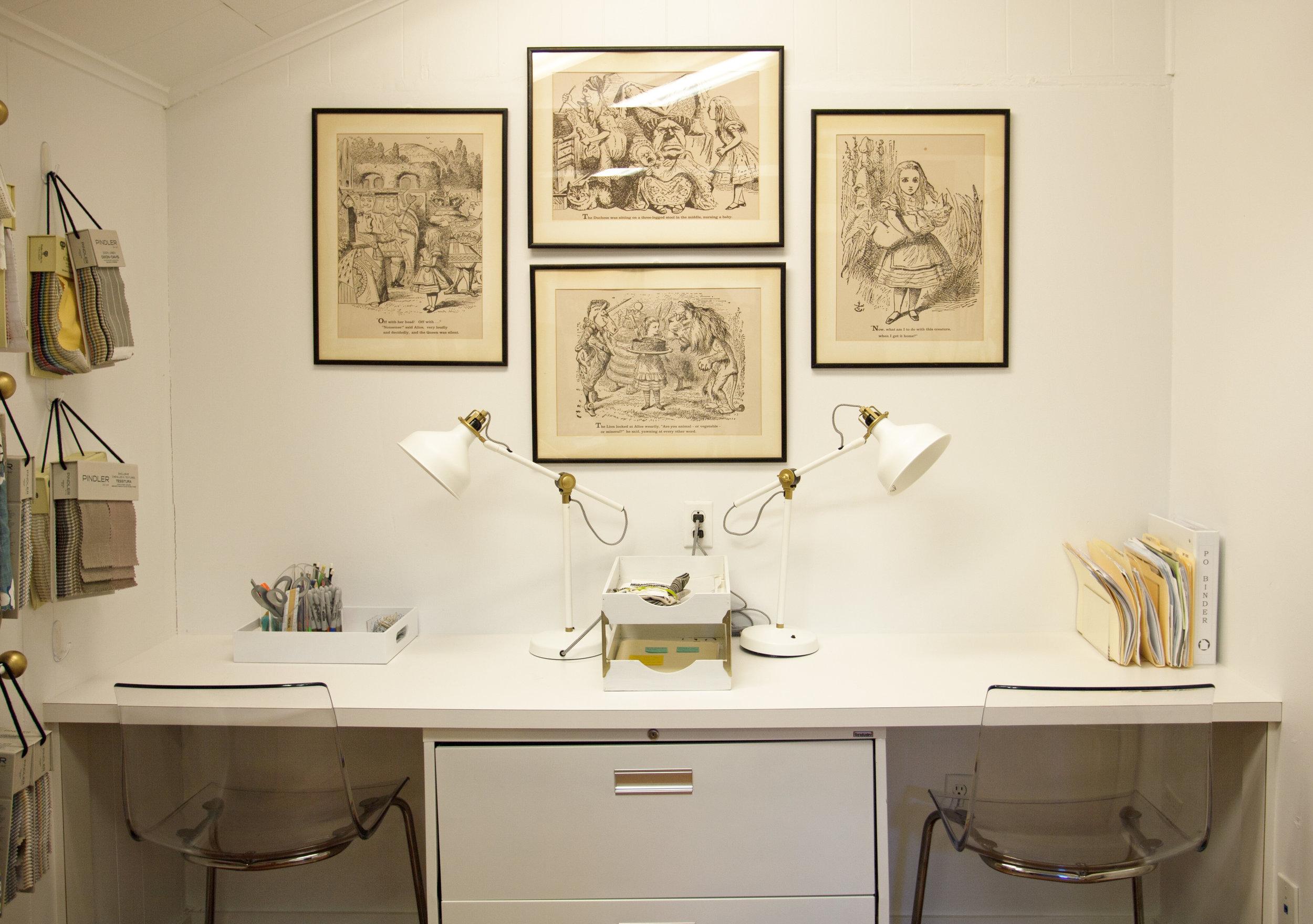 Sample room of interior designer's Montrose Houston design office. Jamie House Design's studio sample room. Vintage Alice in Wonderland prints.