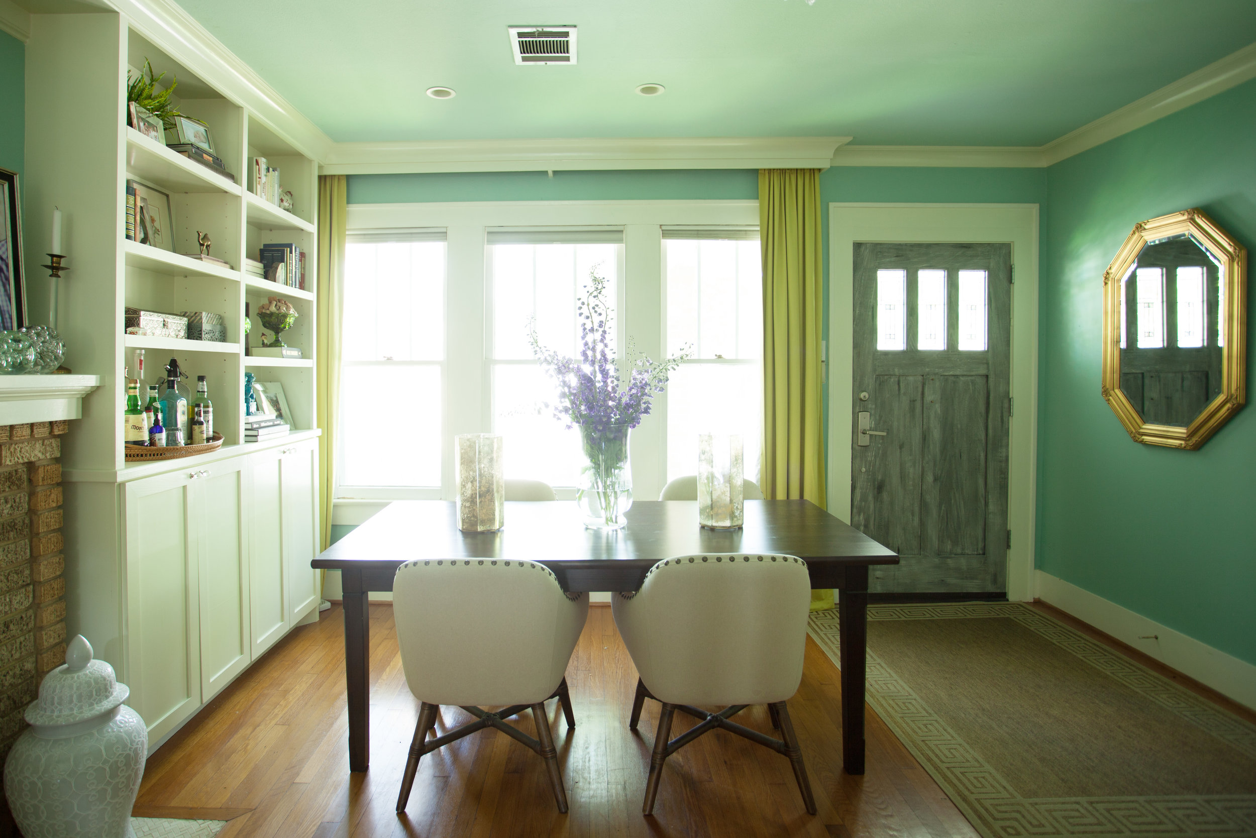 1920's bungalow dining room by Jamie House Design in the Houston Heights. Drapery pocket. Custom built-ins around fireplace