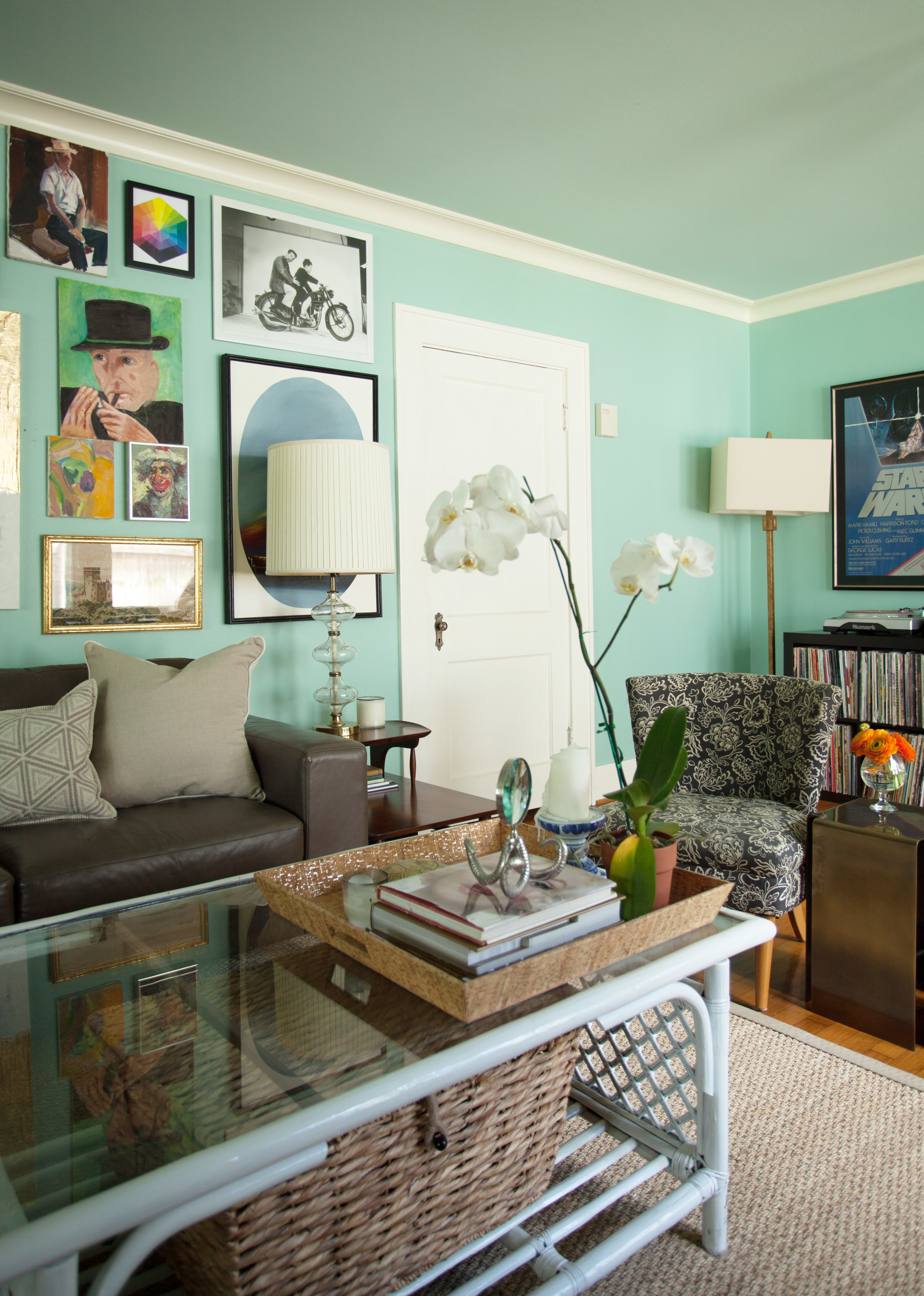 Eclectic living room in 1920s bungalow in Houston Heights by Jamie House Design.