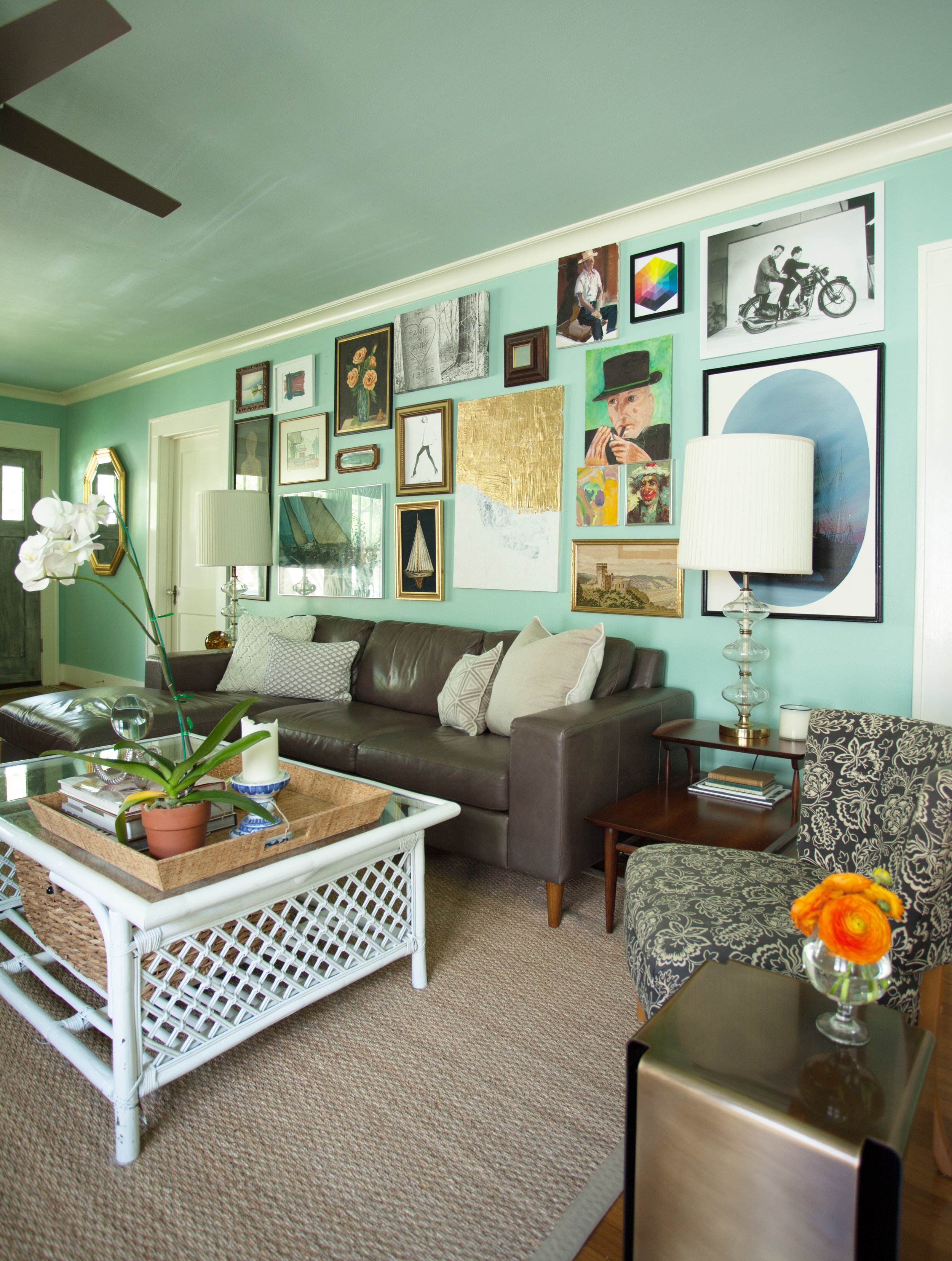 Salon wall behind sectional in 1920s Historic Houston Heights bungalow living room by Jamie House Design