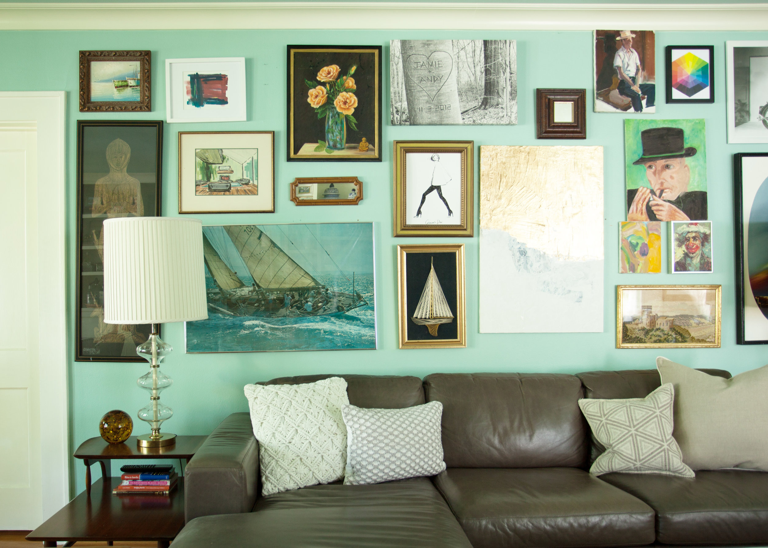 Gallery wall in living room of interior designer Jamie House, in 1920s Historic Houston Heights bungalow