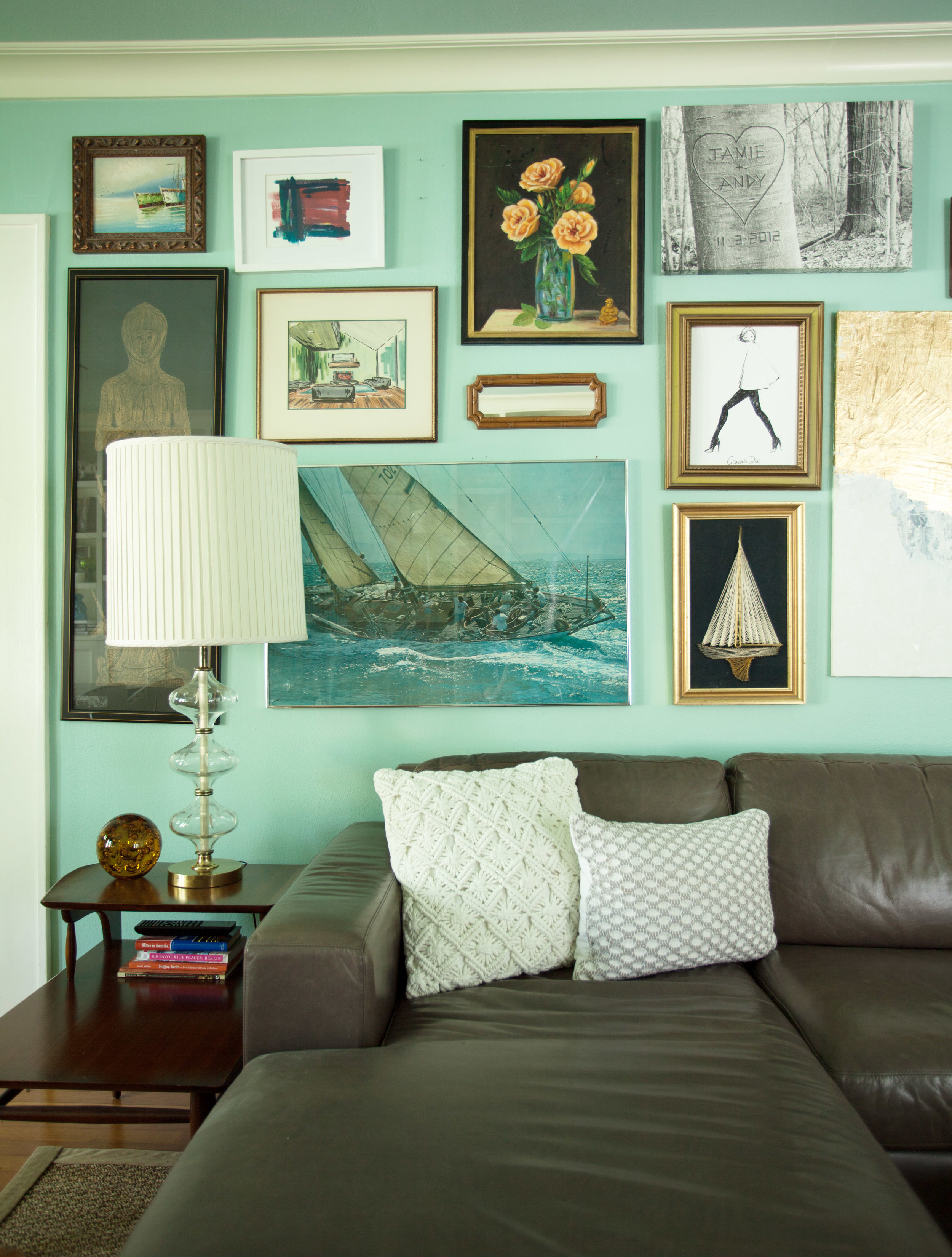 West Elm leather sectional with gallery wall and vintage glass lamps in Houston Heights bungalow by Jamie House Design