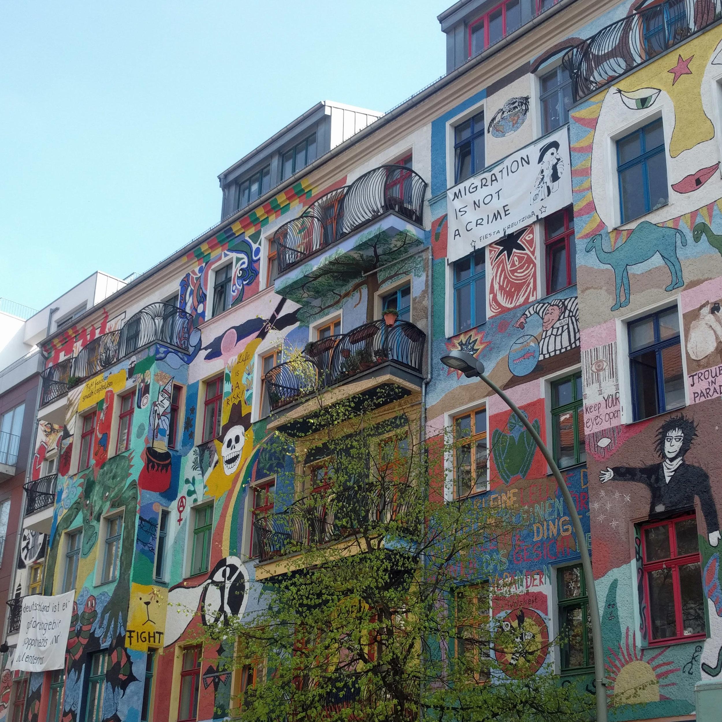 Graffiti art in Friedrichshain Berlin Germany. Colorful altbau building.