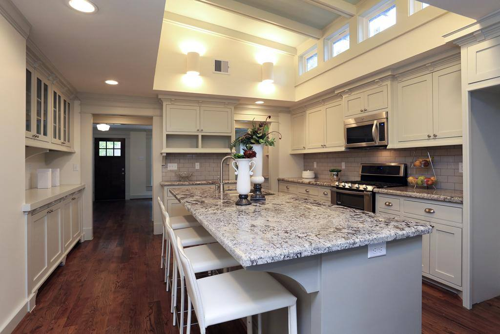 Houston Heights kitchen remodel by Jamie House Design. Raised ceiling, granite counters, and custom cabinets.