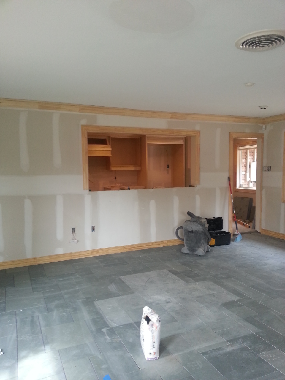 DURING. New tile is in, cabinets in the kitchen are being built.
