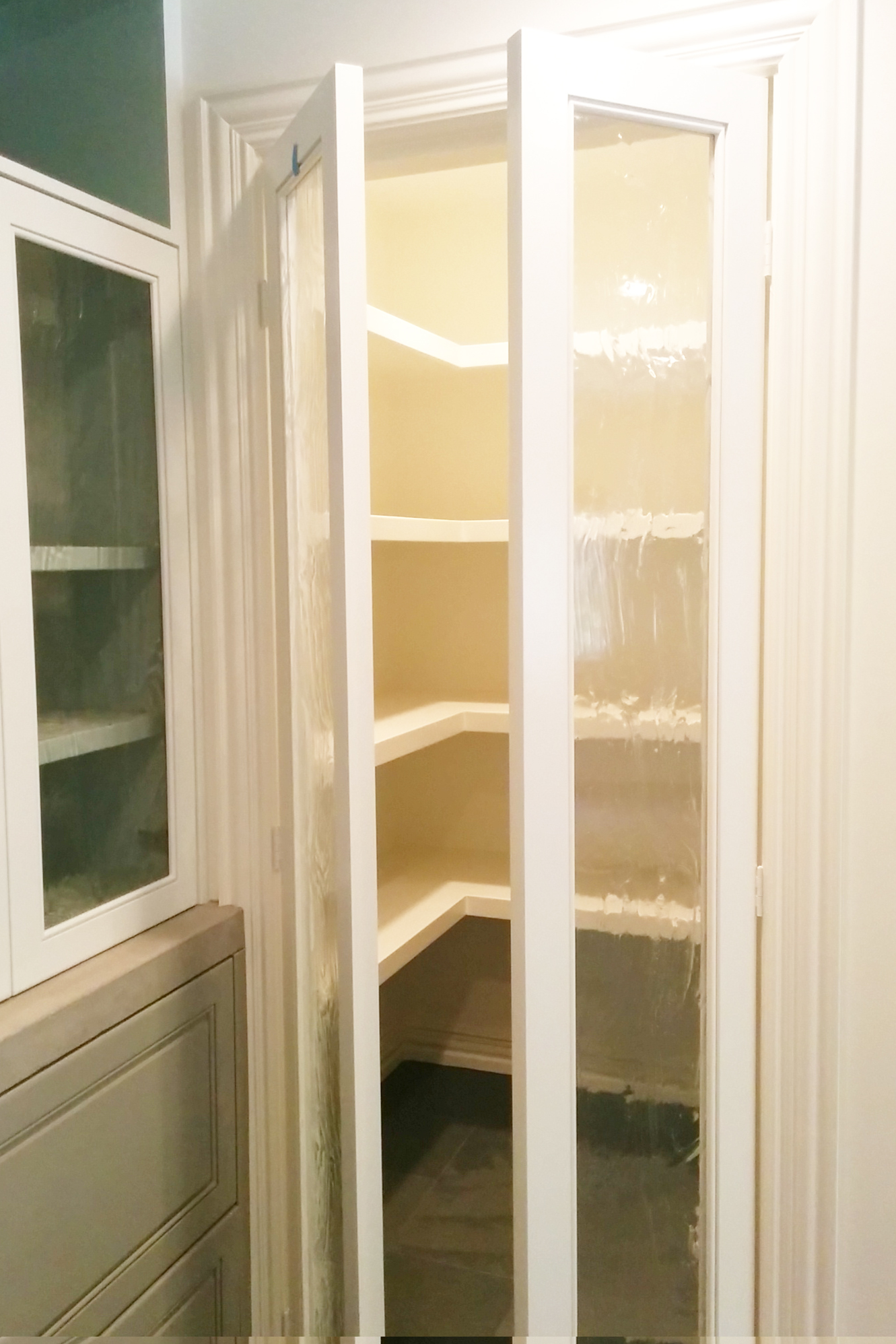 New expanded pantry with textured glass doors. Jamie House Design