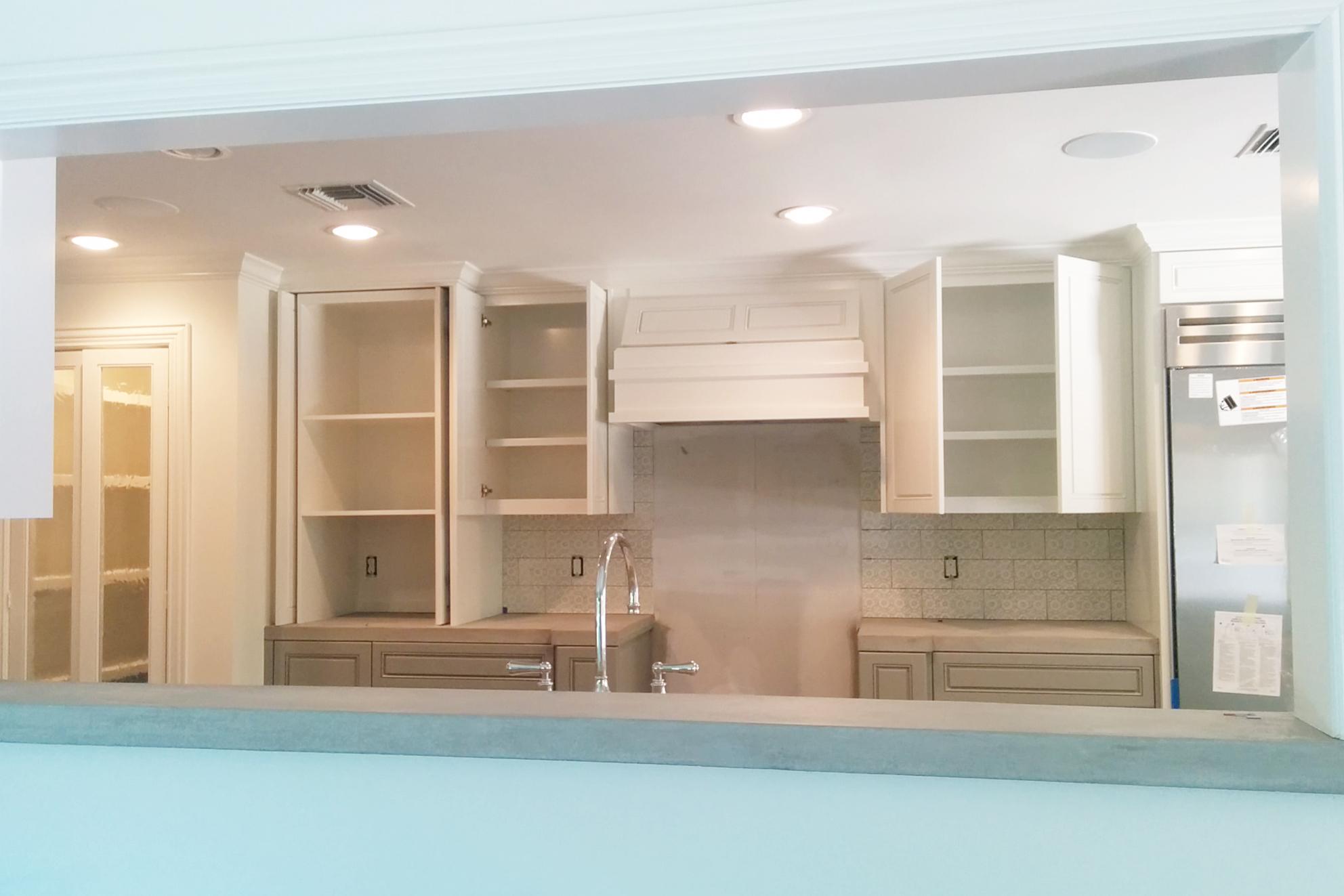 Houston kitchen remodel in progress by Jamie House Design. Concrete counter ledge.