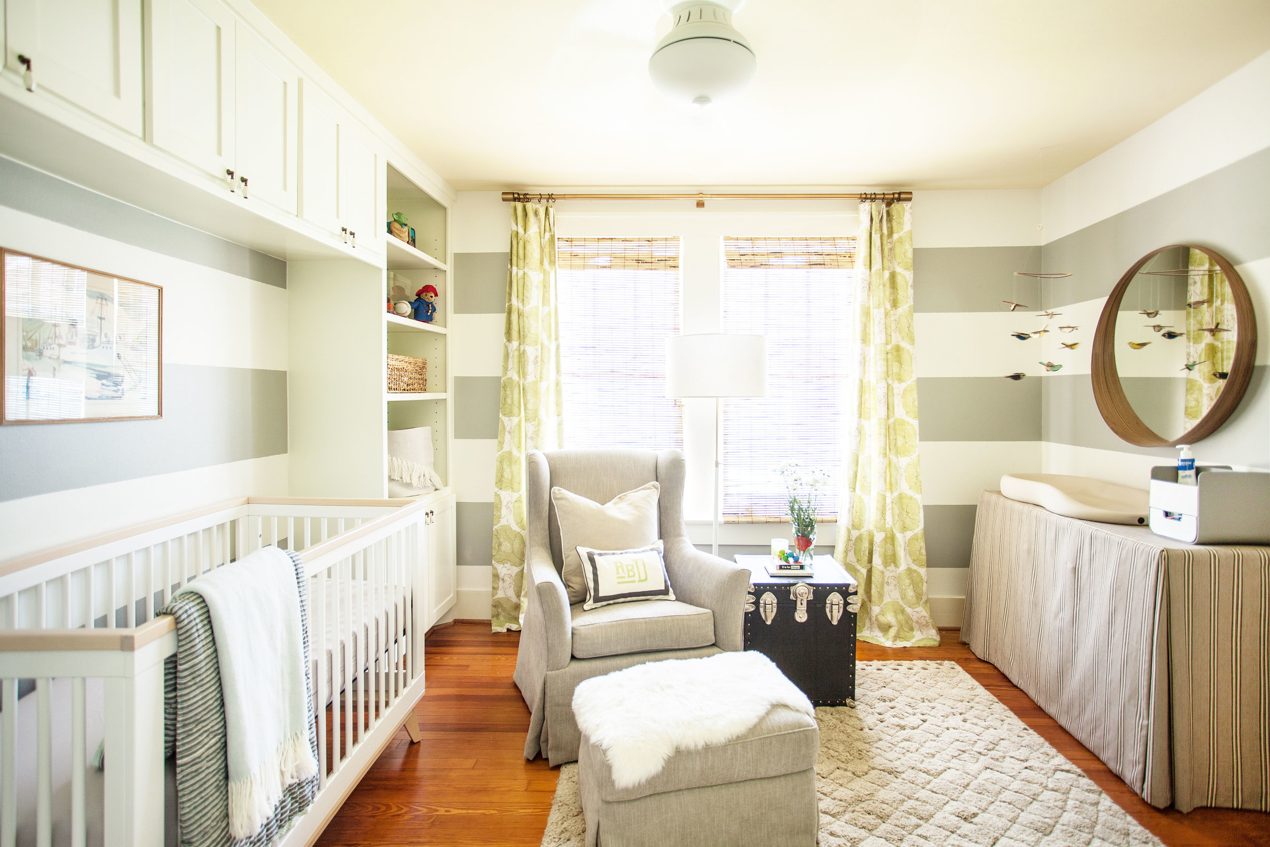 Horizontal grey striped nursery with painted ceiling by Berlin interior designer Jamie House Design