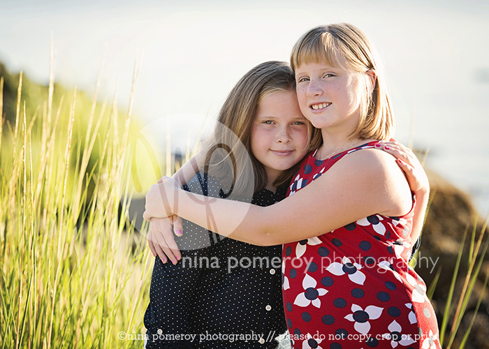sisters portrait by the beach by nina pomeroy