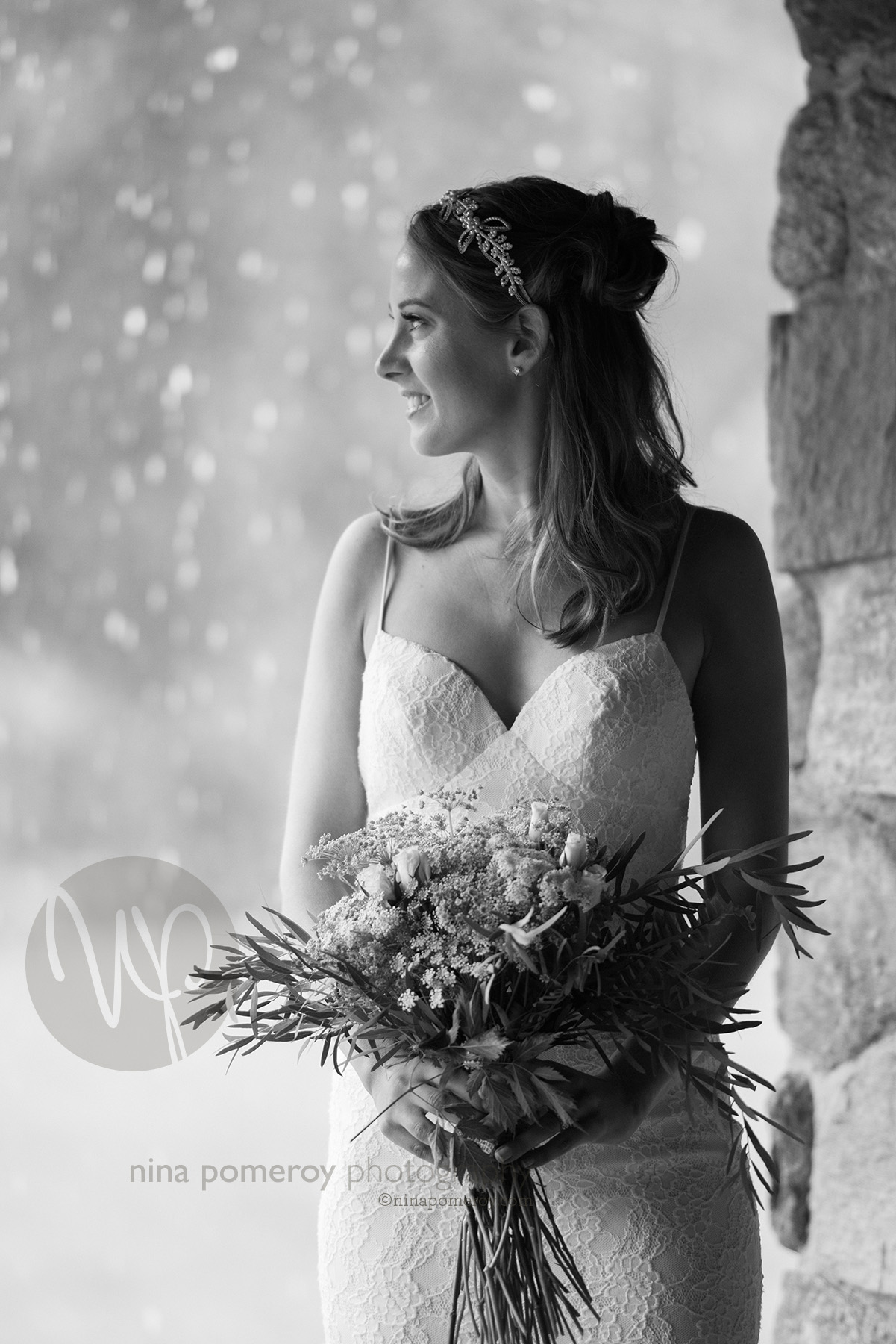 black and white portrait of the Bride waiting for the rain to pass before their vineyard wedding taken by bay area photographer nina pomeroy