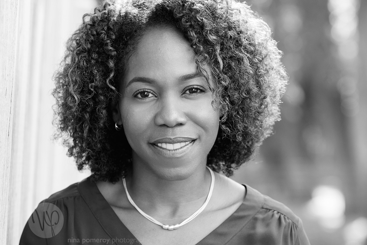 A black and white natural light headshot portrait by San Ramon Photographer Nina Pomeroy of a successful female entrepreneur and businesswoman looking confident.