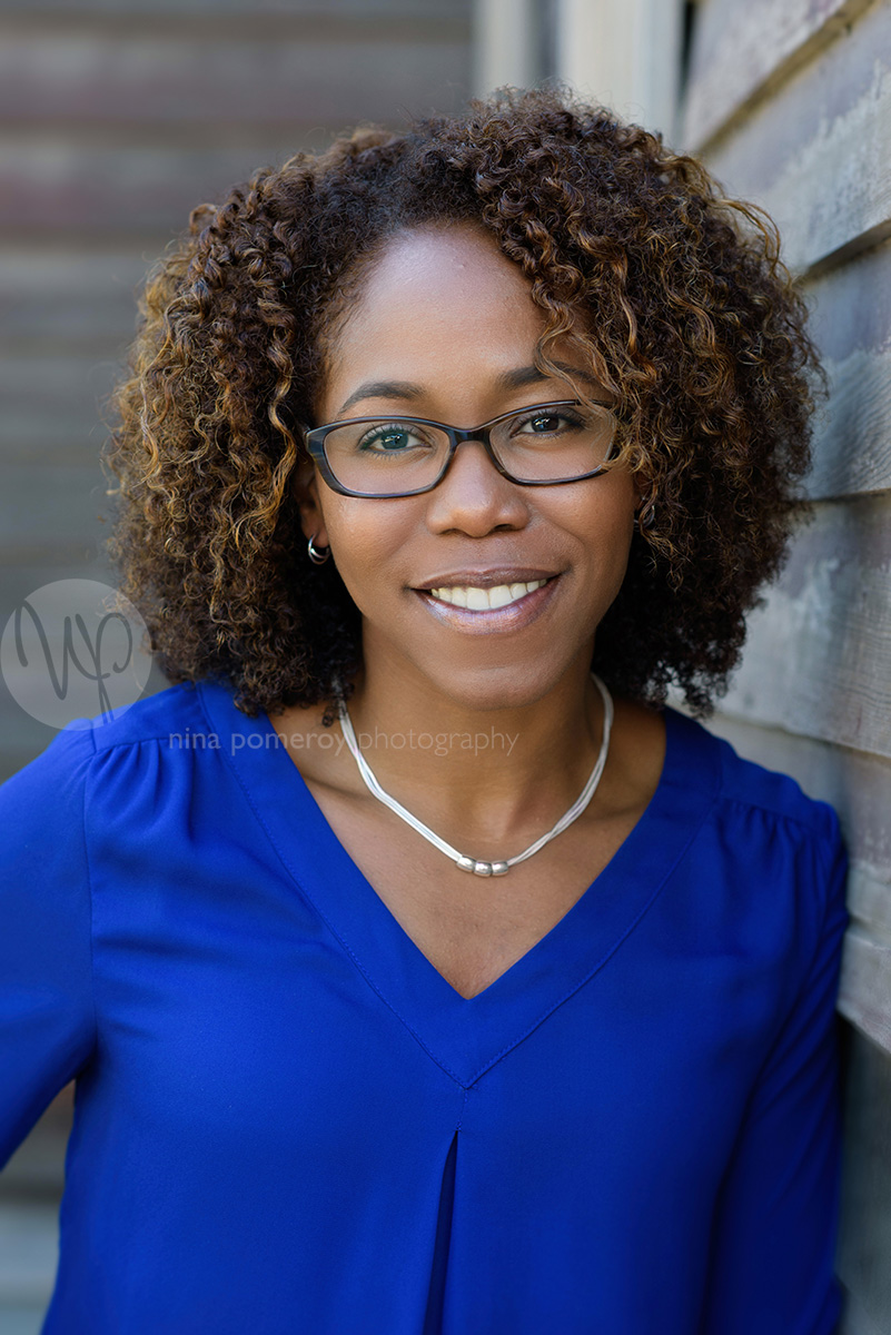 A modern headshot portrait by Nina Pomeroy of an attractive african-american female business owner in Pleasanton California.