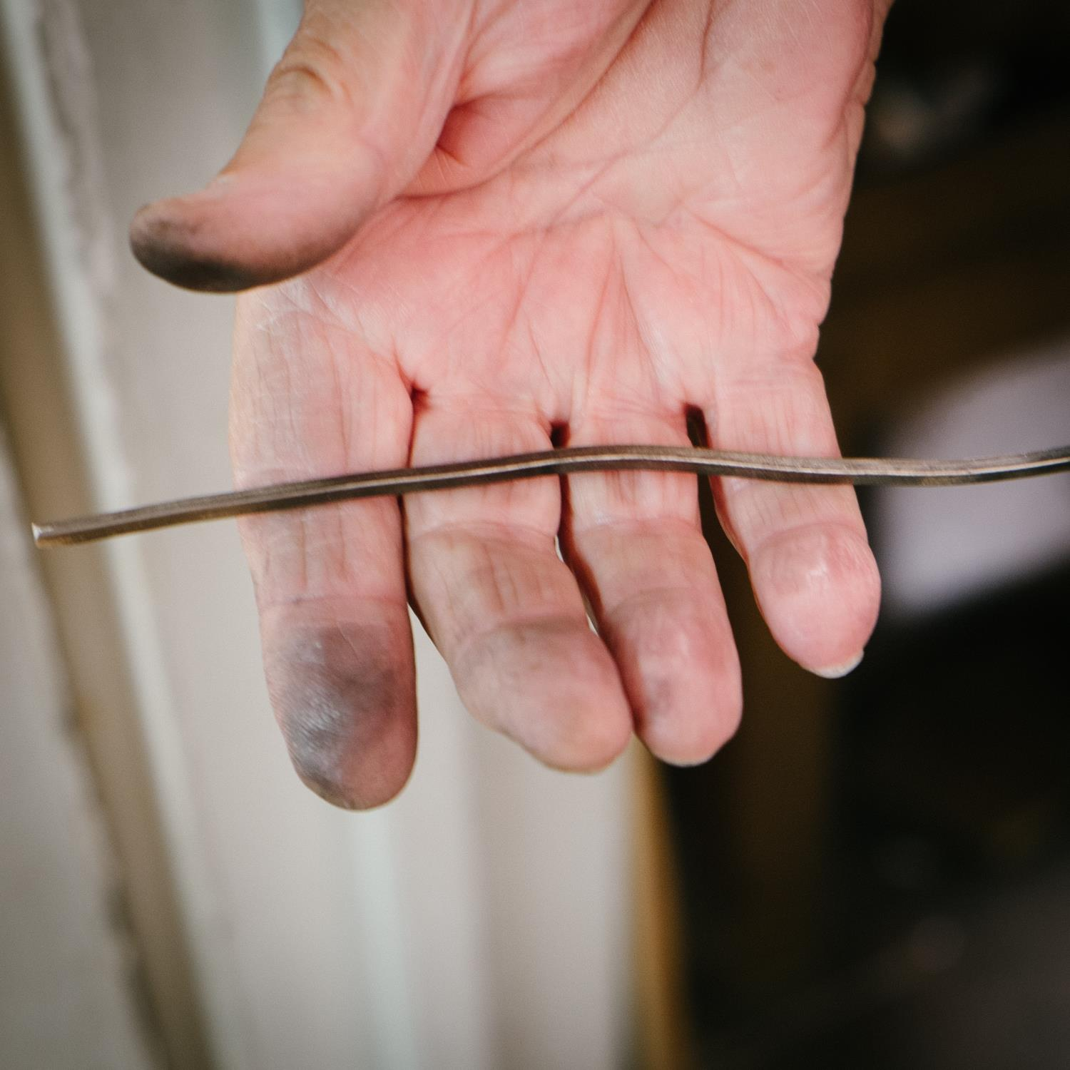 The hammered wire is passed through the roller again, and begins to take on a shinier appearance.