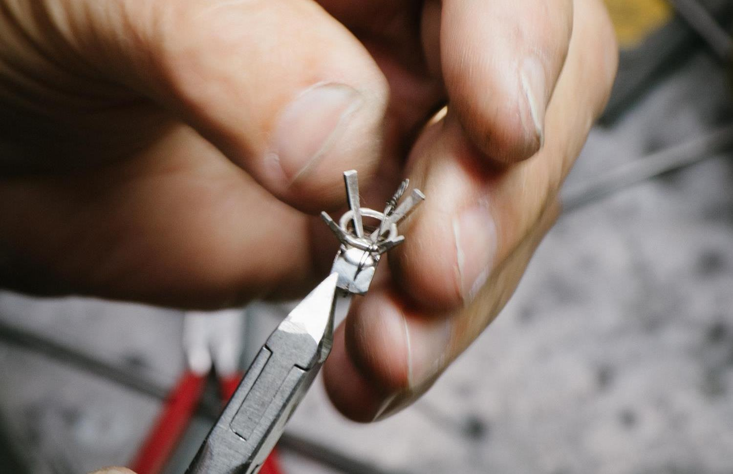 Pieces of wire are then cut to form various portions of the ring head. These are then attached to a plate at the bottom.