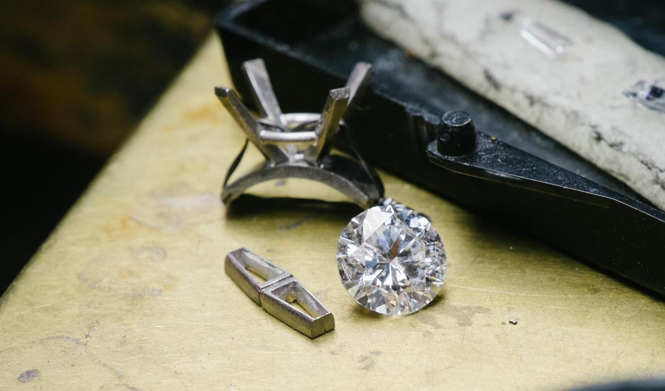 Since this ring had tapered baguettes on the sides, wire is cut and filed to create settings to mouth the baguettes in.
