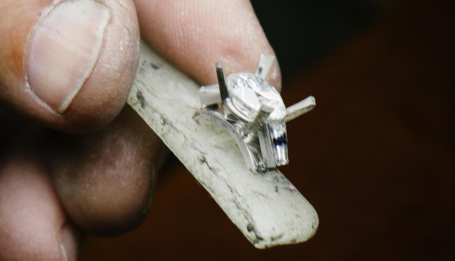 The settings for the baguettes are soldered to the plate and the center stone holder, and the stones are checked to make sure they will fit.