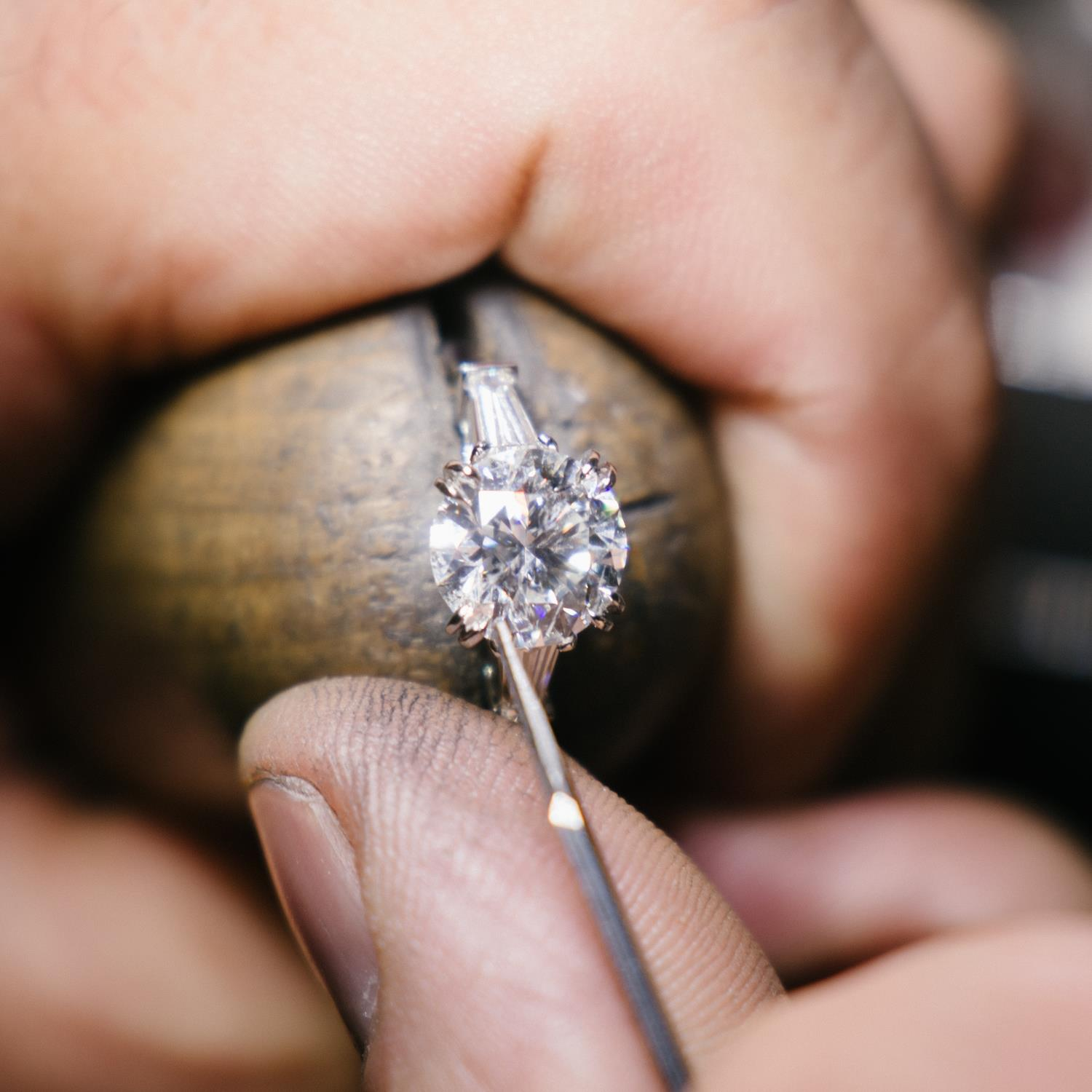 The stones are then set in the platinum, and the ring finally polished.