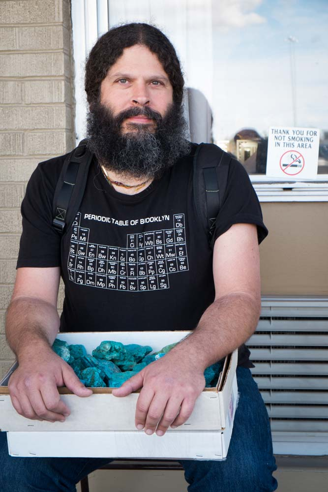 The old spirit of the Tuscon show - individuals from all over the world buying and selling rocks. This cool Brooklynite rocking a beard is holding a box of chrysocolla.