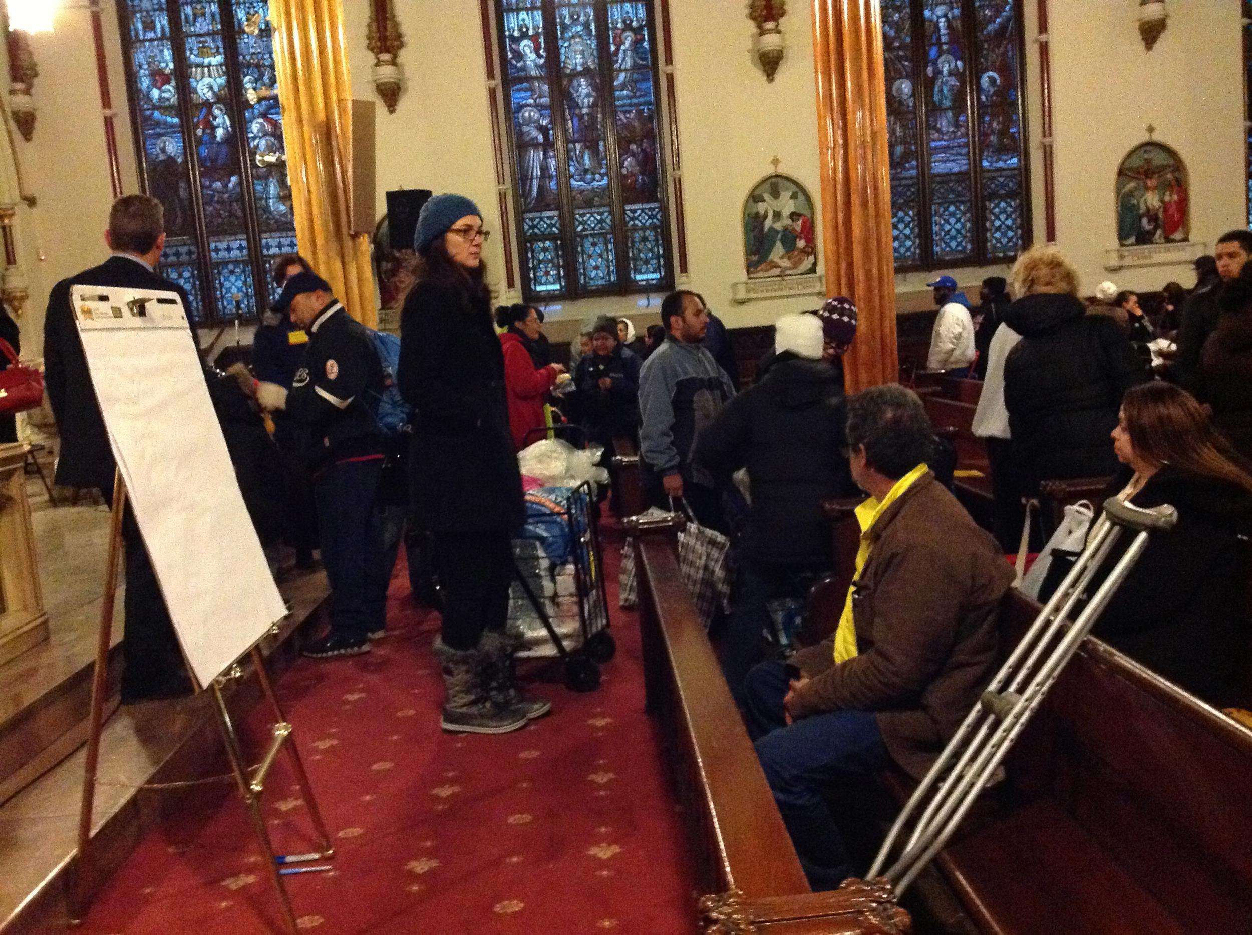 The queue for aid supplies inside Visitation Church