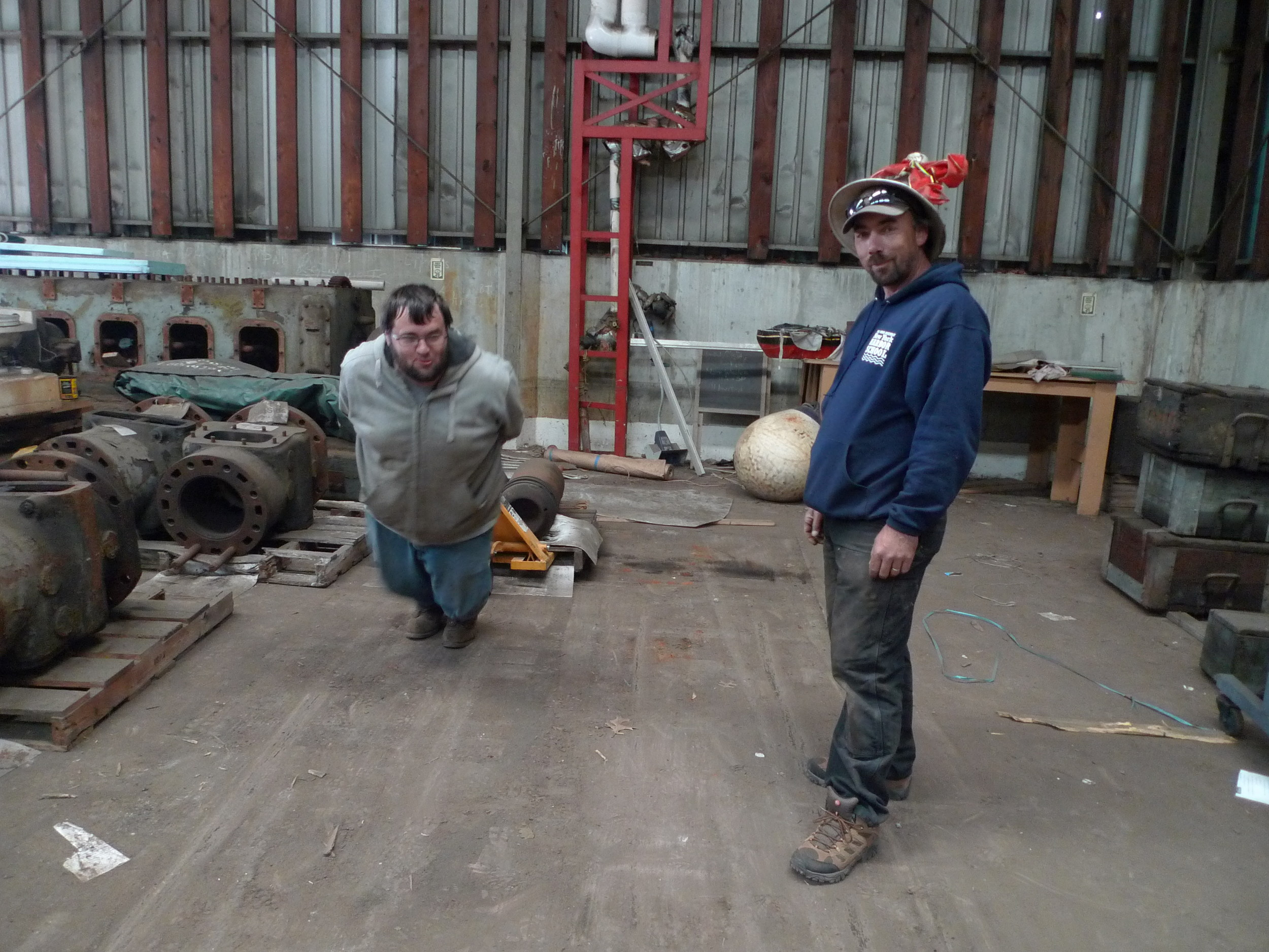 Paul Strubeck pulling out some pistons while Mike Abegg wears part of our Operation Christmas Cheer paraphinalia.