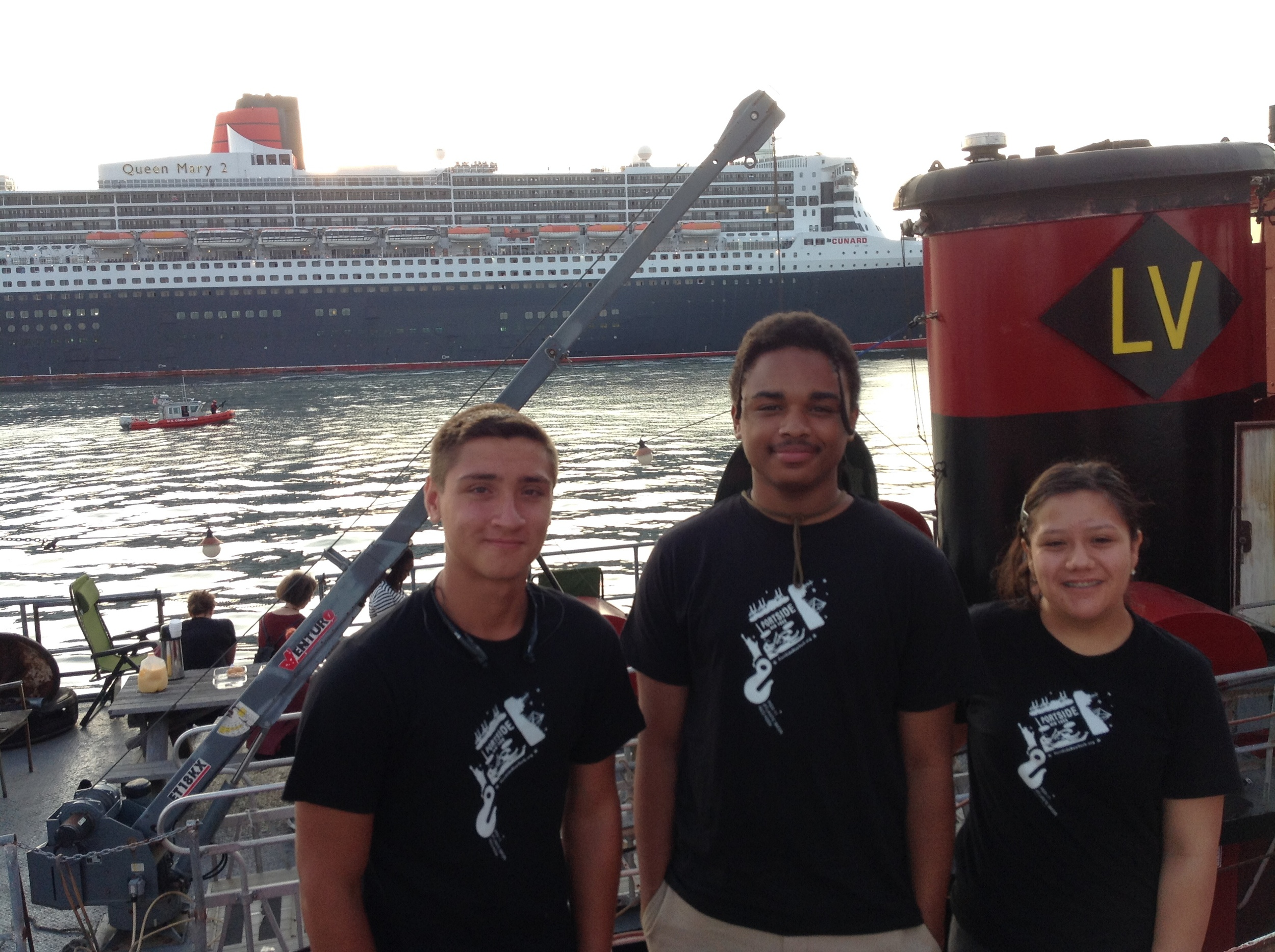 Carlos, Ashby, and Alyson during the Cunard 75th anniversary parade