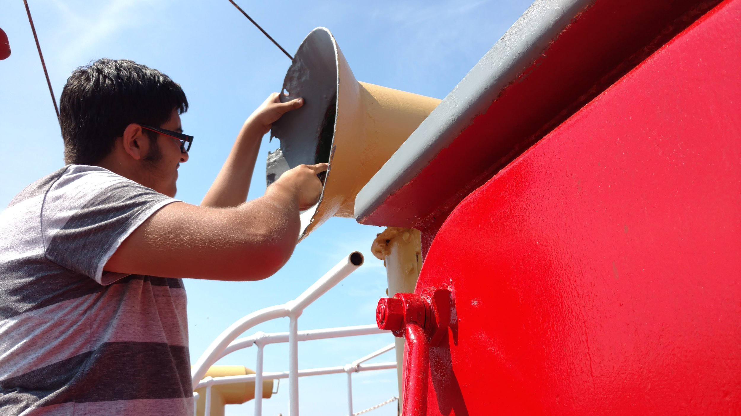 Painting the interior of the vents on the foredeck