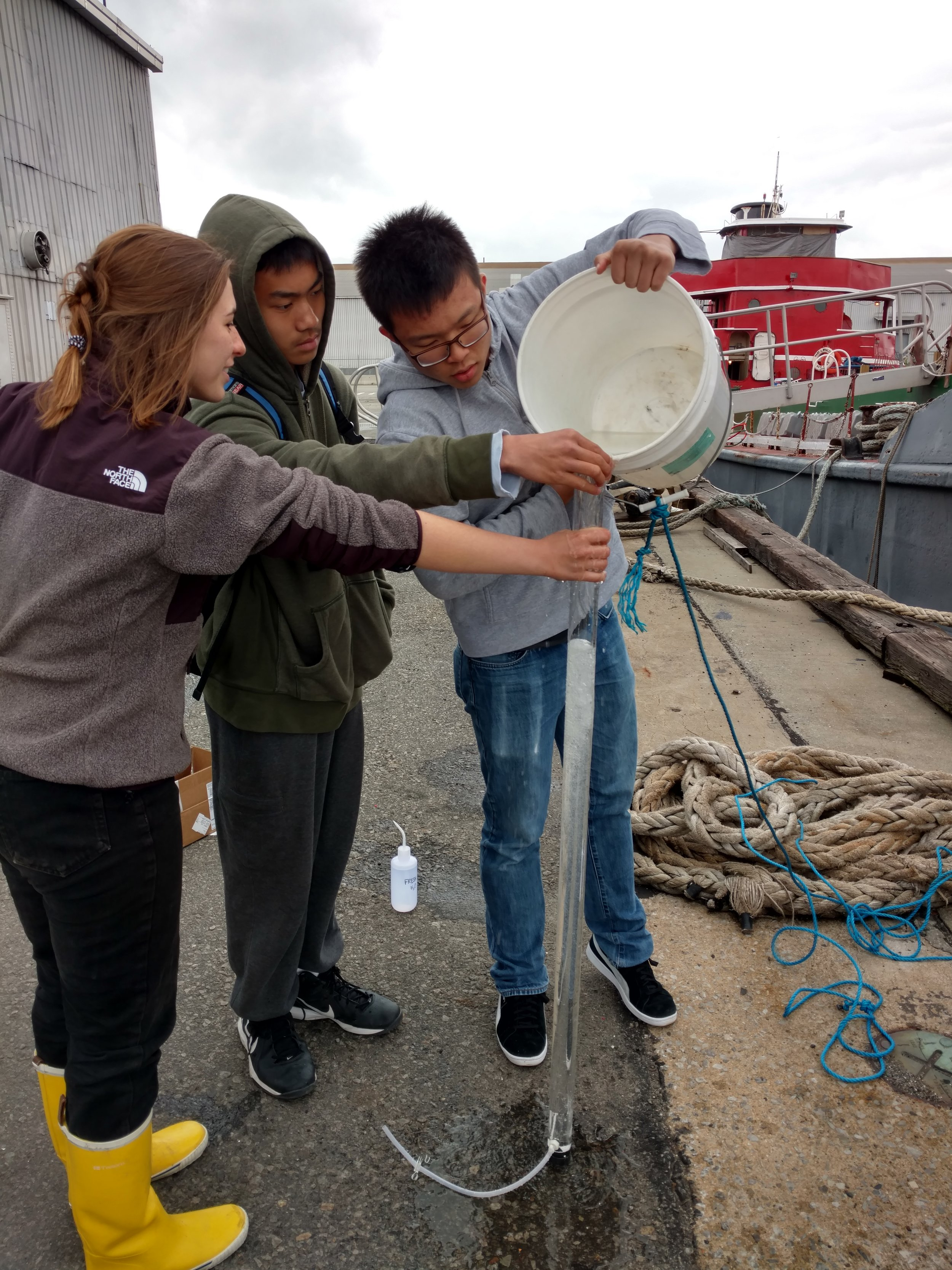 How to do a water test: Emma Garrison showing two students from Stuyvesant HS Environmental Club