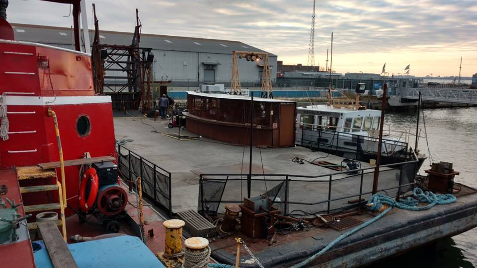the barge from the floating bar/restaurant/small boating center Brooklyn barge arrived for the winter. it is now astern of the mary a. whalen.