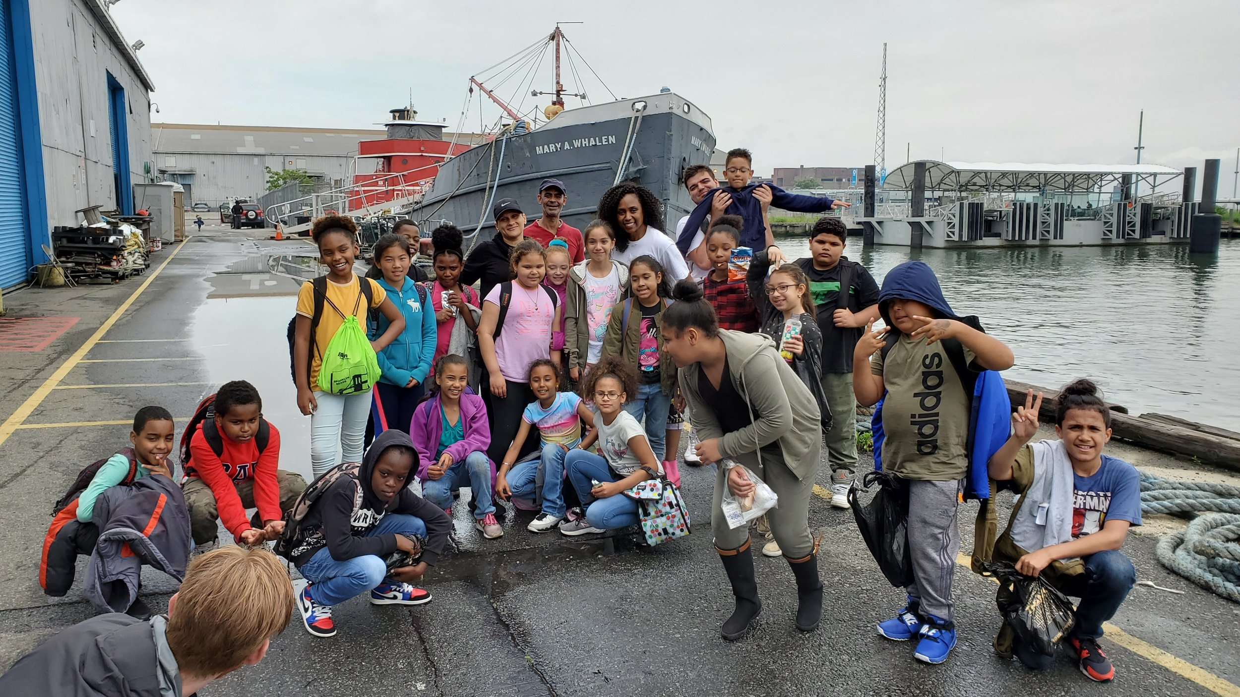 some PS 676 students and staff in front of portside newyork's ship mary a. whalen