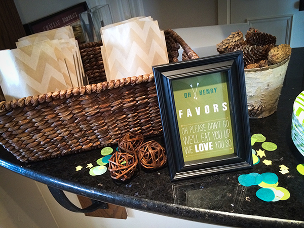 "we presented the favors in a kraft chevron paper sack and guests took home ""o henry"" chocolate bars! they also got to take home pictures from the photo booth!"