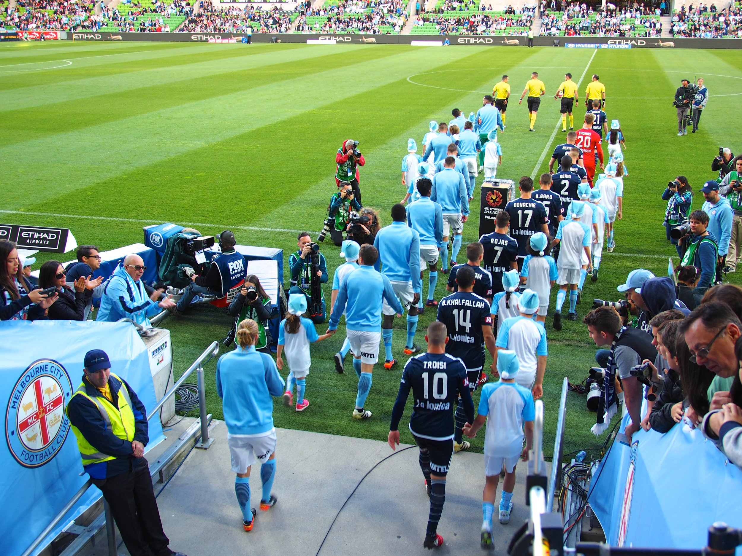 Collingwood kids enjoyed being team mascots for Melbourne City and Melbourne Victory at the start of the match