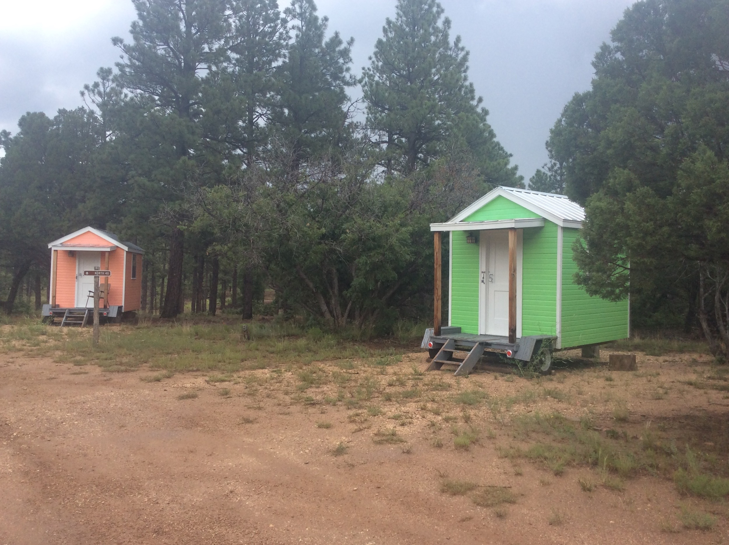 Mini Cabins are circled around the campfire area. Indoor solo and double rooms next to dorm style bathrooms are available, too.