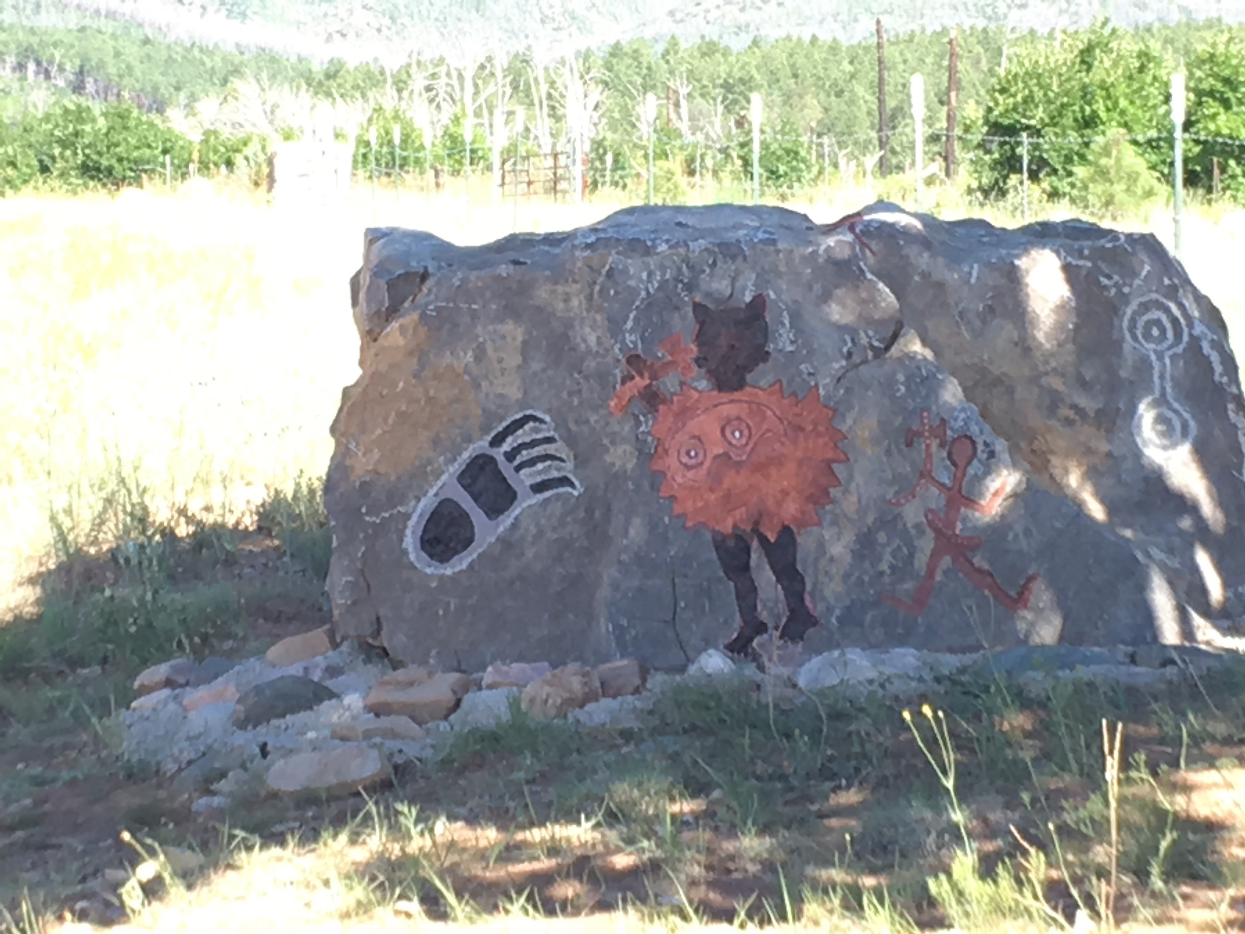 My inner critic at times looks like this petroglyph, (our version at The Camp at Capilla Peak) a hatchet bearing, shield wielding panther woman.