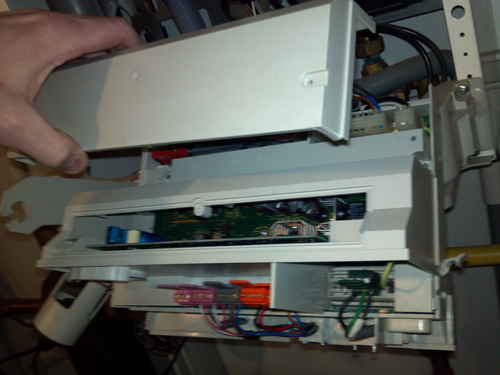 6.) Loosen the 2 screws on the top back cover, one each side, and remove.