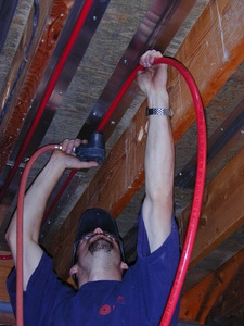 Radiant PEX tubing is installed in ThermoFin using a pneumatic palm hammer - click image for more info on installation tools.