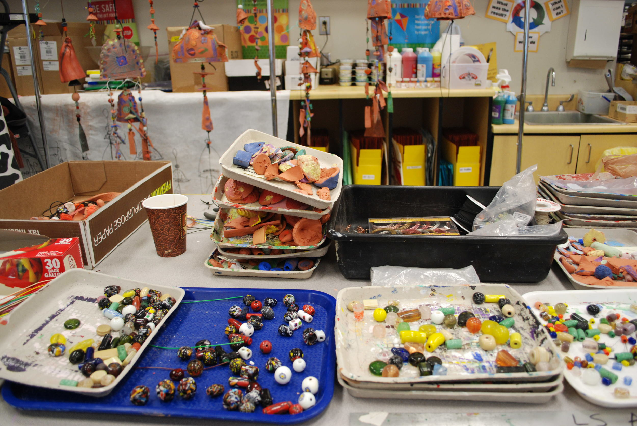 4th grade wind chime project - Take our 4th grade young artists at Christ Church Episcopal School and add creativity plus skillful hands, glassbeads and an assortment of student made parts and pieces and guess what you have???? Check in tomorrow to see the results!....