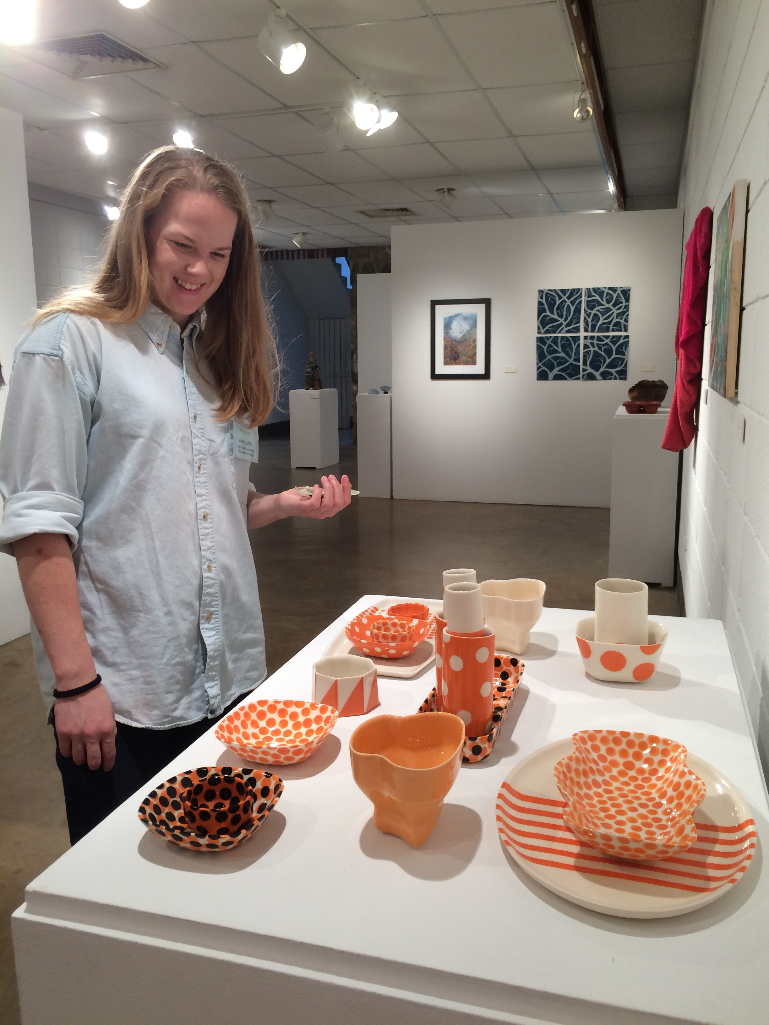 """My assistant,Glory Day Loflin, inspecting the instructor's show installed in the elegant, mid-century modern style gallery space at Arrowmont and Day 1 of the workshop """"Finding Your Form Through Nature""""."""