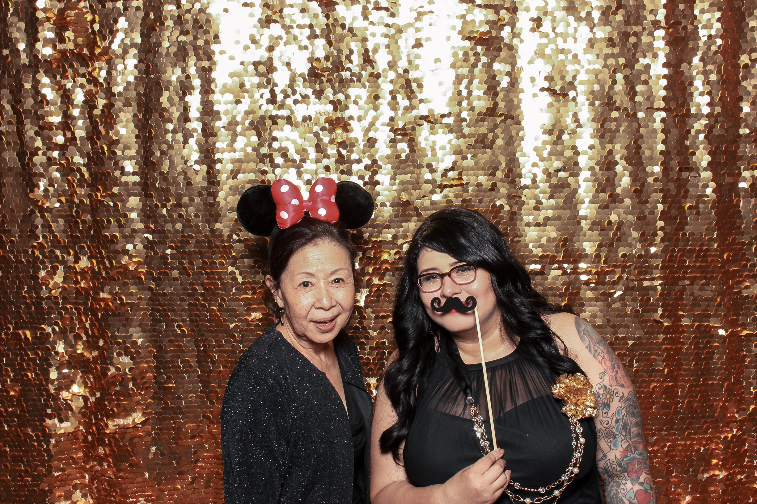 My friends had a Photo Booth and I loved how fun it was. We were awkward, funny, and you really get to know someone when they pick up a prop. This is my friend's aunt, how adorable and cool is she in those Minnie ears??