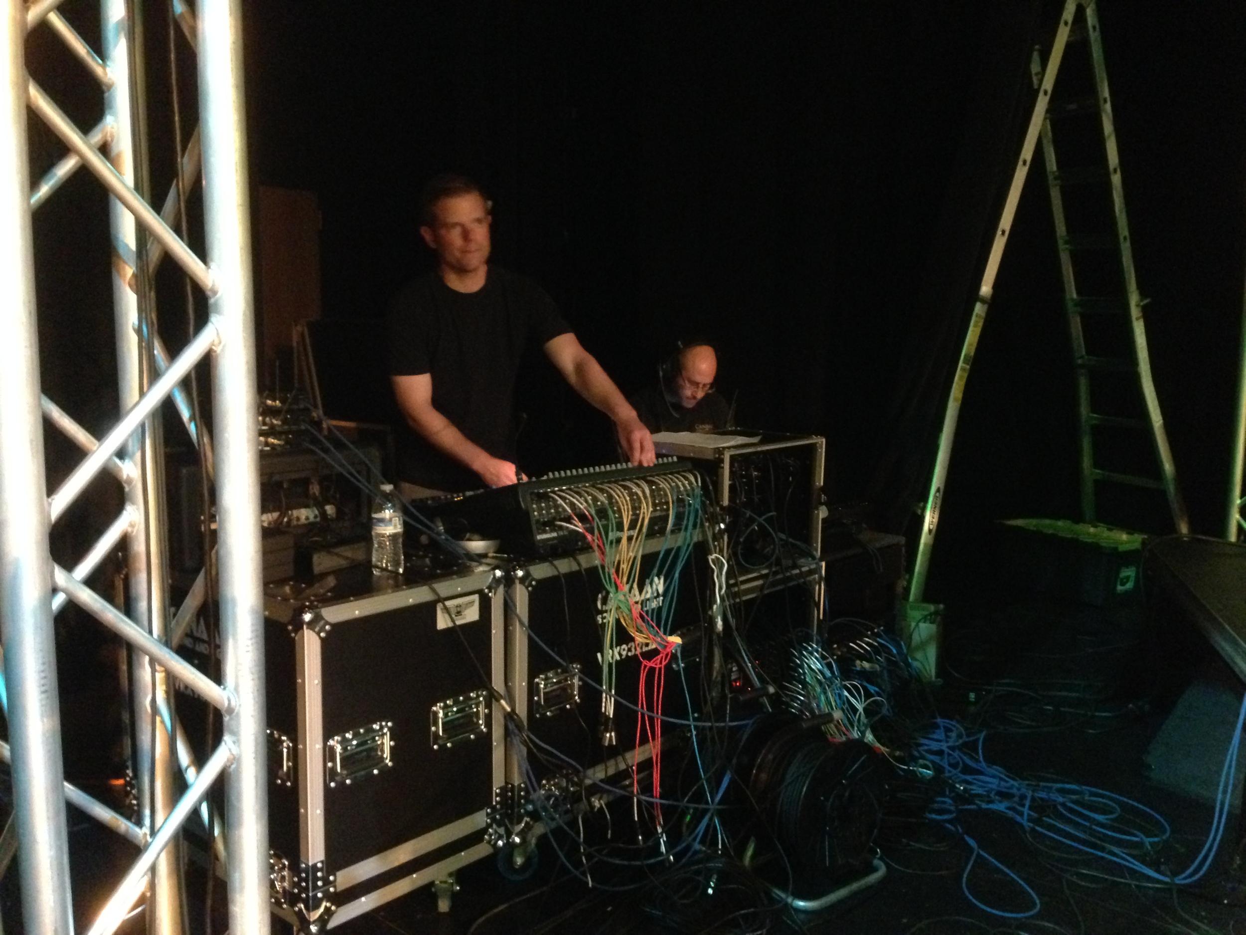 Dan on their PreSonus mixing monitors. Mike on the lighting controller.