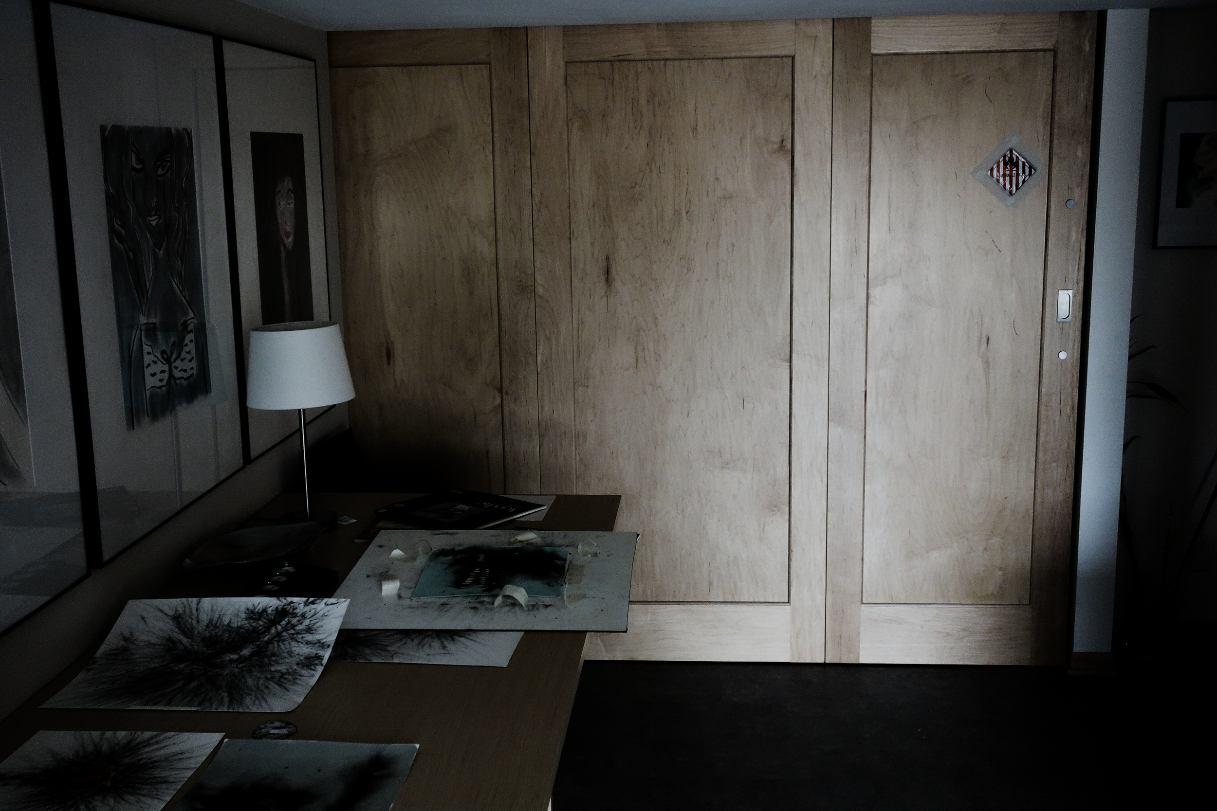 "Studio sliding ""blast"" doors with warning sticker."