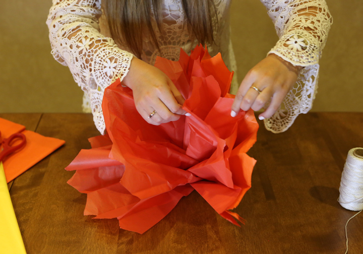 Step 8: Start to pull apart each sheet of tissue paper to give your flower some depth.